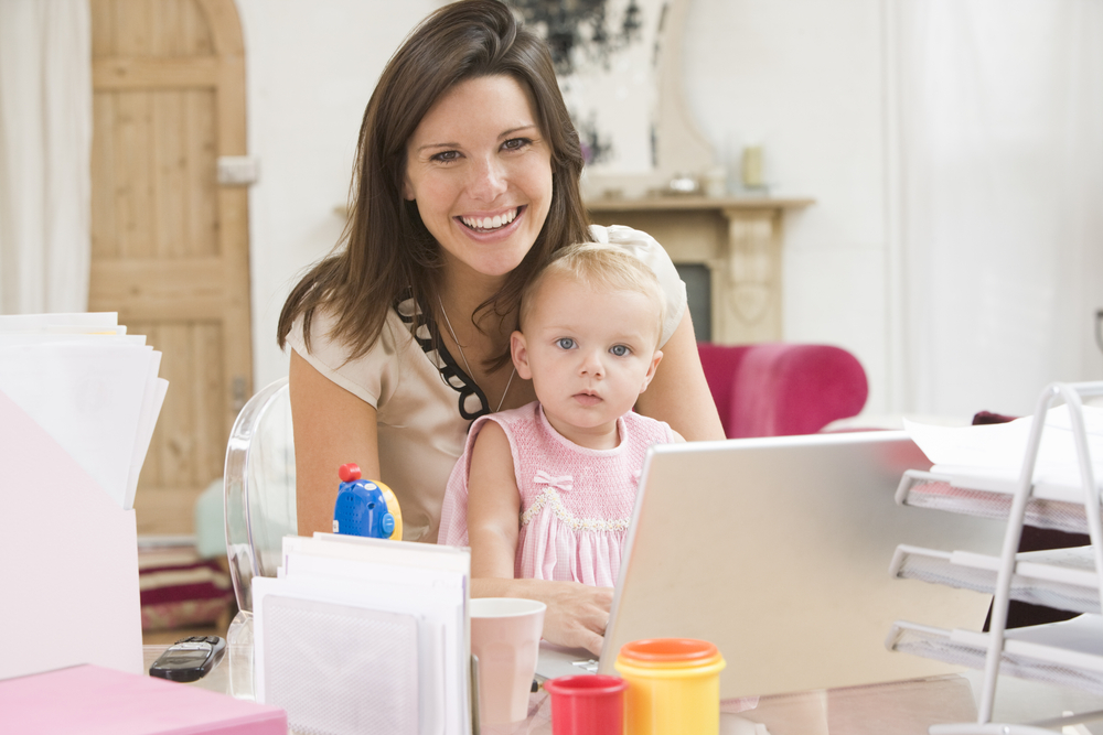 mum and baby on laptop